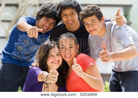 Teenagers Posing Outside School