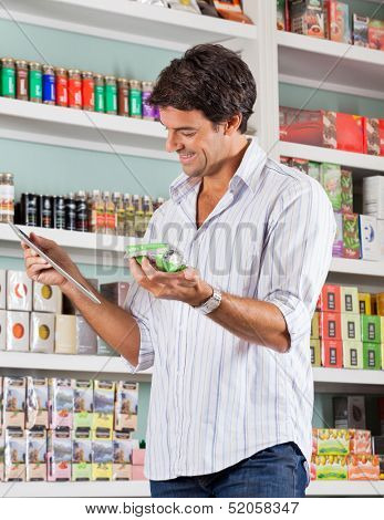 Happy mid adult male customer checking list in grocery store