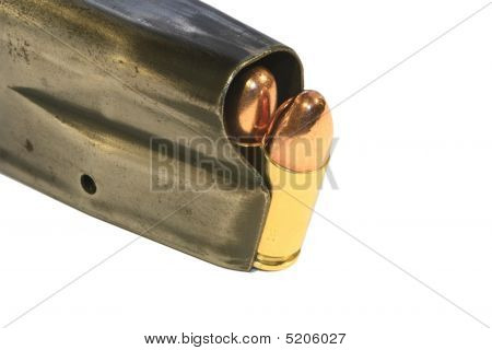 9Mm Bullets In A Magazine On White
