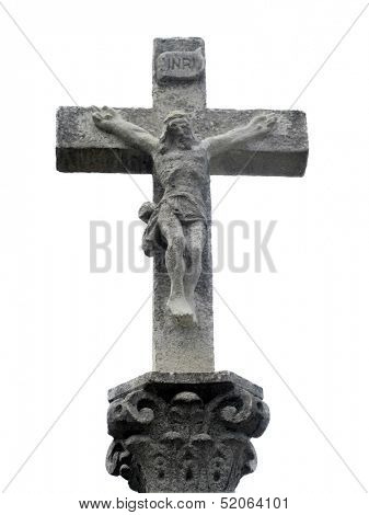 Stone cross with Christ crucified located on the Road To Santiago