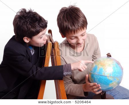 Two Boys Researching Sphere Isolated On White