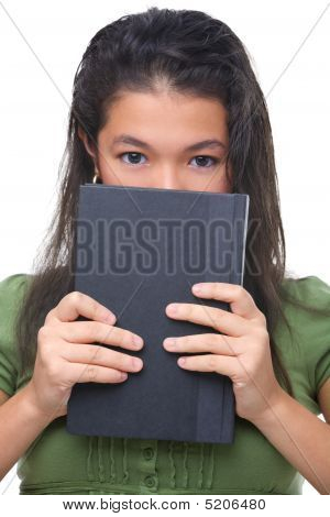Female Teenager Hiding Hal Her Face Behind Book