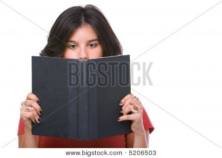 Female Teenager Reading Book