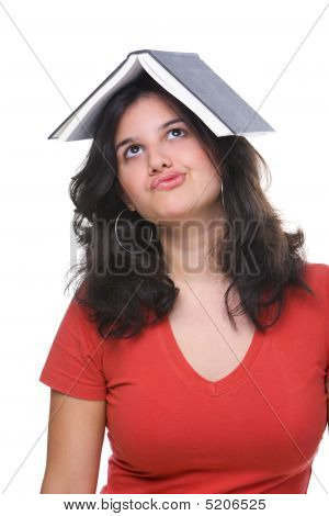 Female Teenager Bored And Burdened By Book
