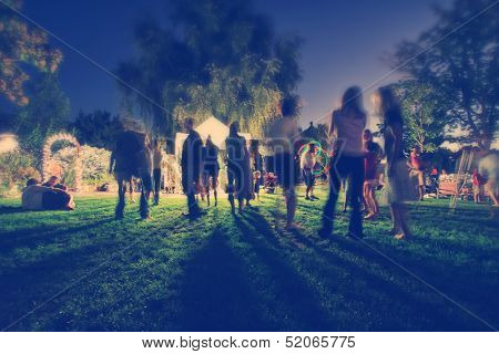 people mingling at a free concert by local musicians