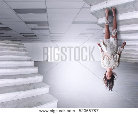 a beautiful woman defying gravity in a large empty warehouse