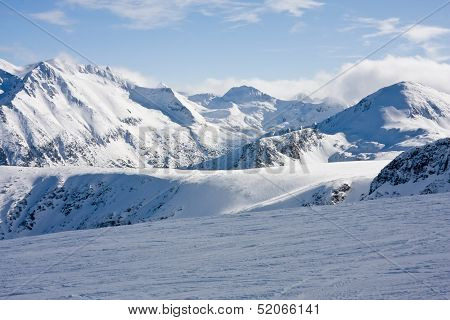 Ski Slope In Winter Mountains