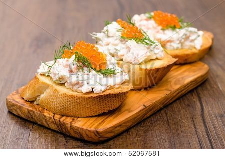 Italian Crostini On A Wooden Board