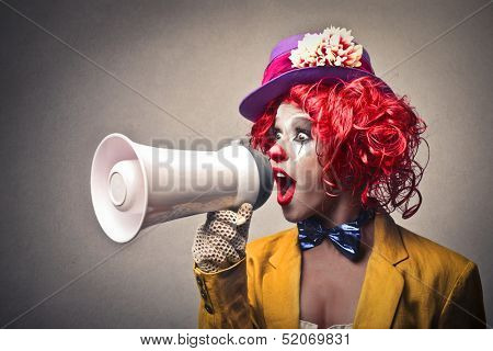 beautiful clown speaking with megaphone