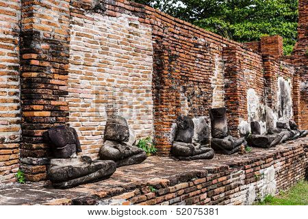 Row of broken buddha at Ayuttaya, Thailand