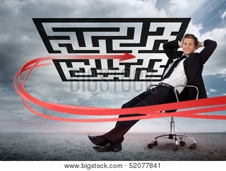 Businessman sitting in front of red arrow through qr code smiling at camera in swivel chair