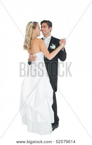 Cute young married couple dancing viennese waltz on white background