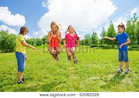 Girls Jumping Over The Rope With Friends