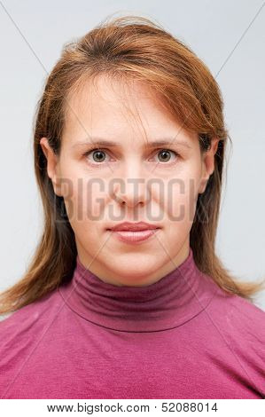 Closeup Studio Face Portrait Of Young Caucasian Ordinary Woman Isolated On Gray Background