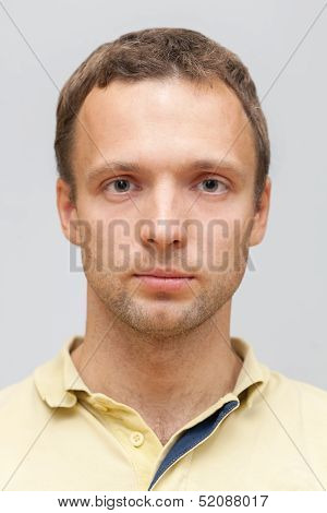 Closeup Studio Face Portrait Of Young Caucasian Ordinary Man Isolated On Gray Background