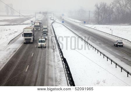 Highway traffic in heavy snowfall