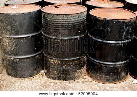 Row Of Rusting Black Drums