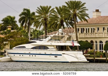 White Yacht By Mansion On Canal