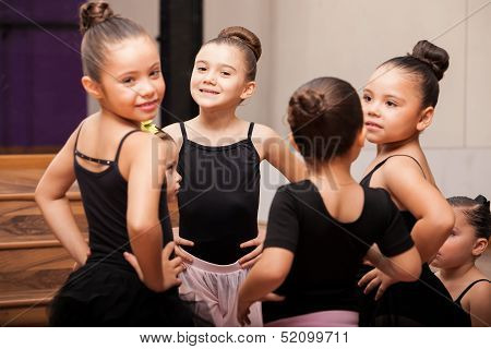 Happy little girls in ballet class