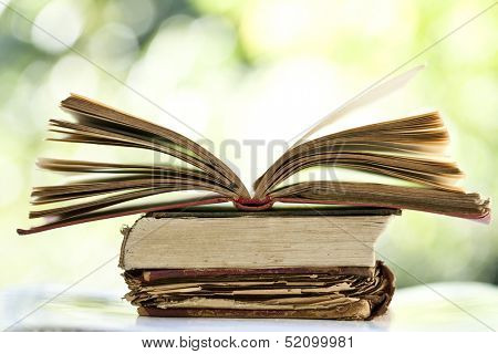 Close up on old book on colorful bokeh background