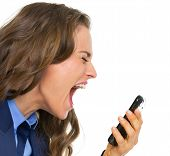 image of shouting  - Angry business woman shouting in mobile phone - JPG