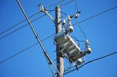 stock photo of utility pole  - Modern technology in transformer and relay design makes for a neater looking utility pole.