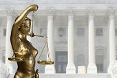 stock photo of scales justice  - Justice statue is on against the courthouse - JPG