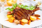 stock photo of veal meat  - Veal chop with vegetables for Christmas dinner - JPG