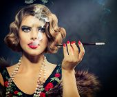 Smoking Retro Woman Portrait. Beauty Girl with Mouthpiece. Vintage Styled Beautiful Lady with cigare
