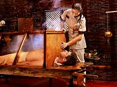 image of sauna woman  - Woman having Ayurvedic sauna treatment - JPG