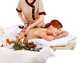 Young woman getting spa lastone therapy outdoor. Isolated. poster
