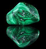 foto of malachite  - malachite mineral stone close up  with reflection on black surface background - JPG