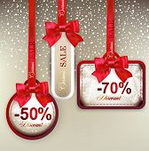 foto of bowing  - Set of sale and discount paper labels with red bows and ribbons - JPG