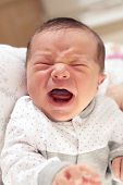 stock photo of born  - Cute New Born Baby Crying Loudly with Facial Gesture - JPG