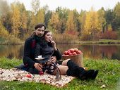 stock photo of hookah  - relationship between man and a woman at a picnic with a hookah - JPG