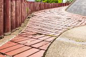 pic of paving  - Sidewalk Curving walk from Paving Stones and wood walls garden - JPG
