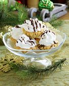 sweet dessert tartlets with meringue and chocolate