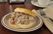 stock photo of biscuits gravy  - A variation of chipped beef on toast using ground beef and white sauce on a fresh baked biscuit - JPG