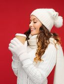 winter, people, happiness, drink and fast food concept - woman in hat with takeaway tea or coffee cu