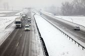 stock photo of snowy-road  - Highway traffic in heavy snowfall - JPG