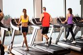 stock photo of cardio exercise  - Group of people running on treadmills - JPG