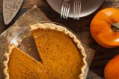 stock photo of pumpkin pie  - Homemade Delicious Pumpkin Pie made for Thanksgiving