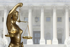 image of metal sculpture  - Justice statue is on against the courthouse  - JPG