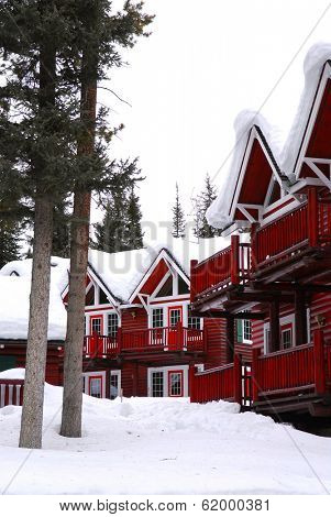 Log buildings of a mountain lodge in winter at ski resort