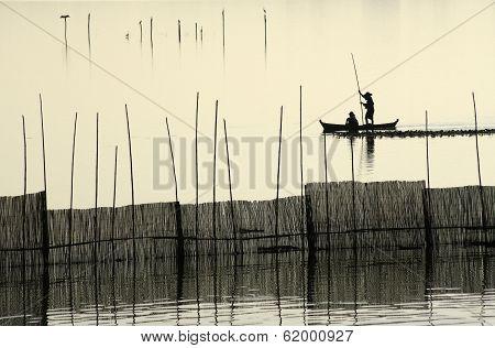 A Fisherman Silhouette Near U Bein's Bridge At Sunset.