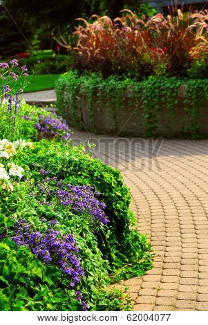 Formal garden with blooming flowers in the summer
