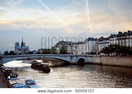 View of Seine and Notre Dame cathedral in Paris, France in the evening