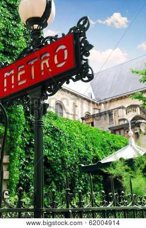 Metro sign at Saint Germain de Pres cathedral in Paris, France