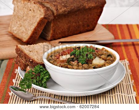 Healthy Lentil, Spinach Soup With Quinoa Bread.
