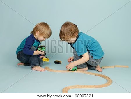 Kids Playing With Toy Trains